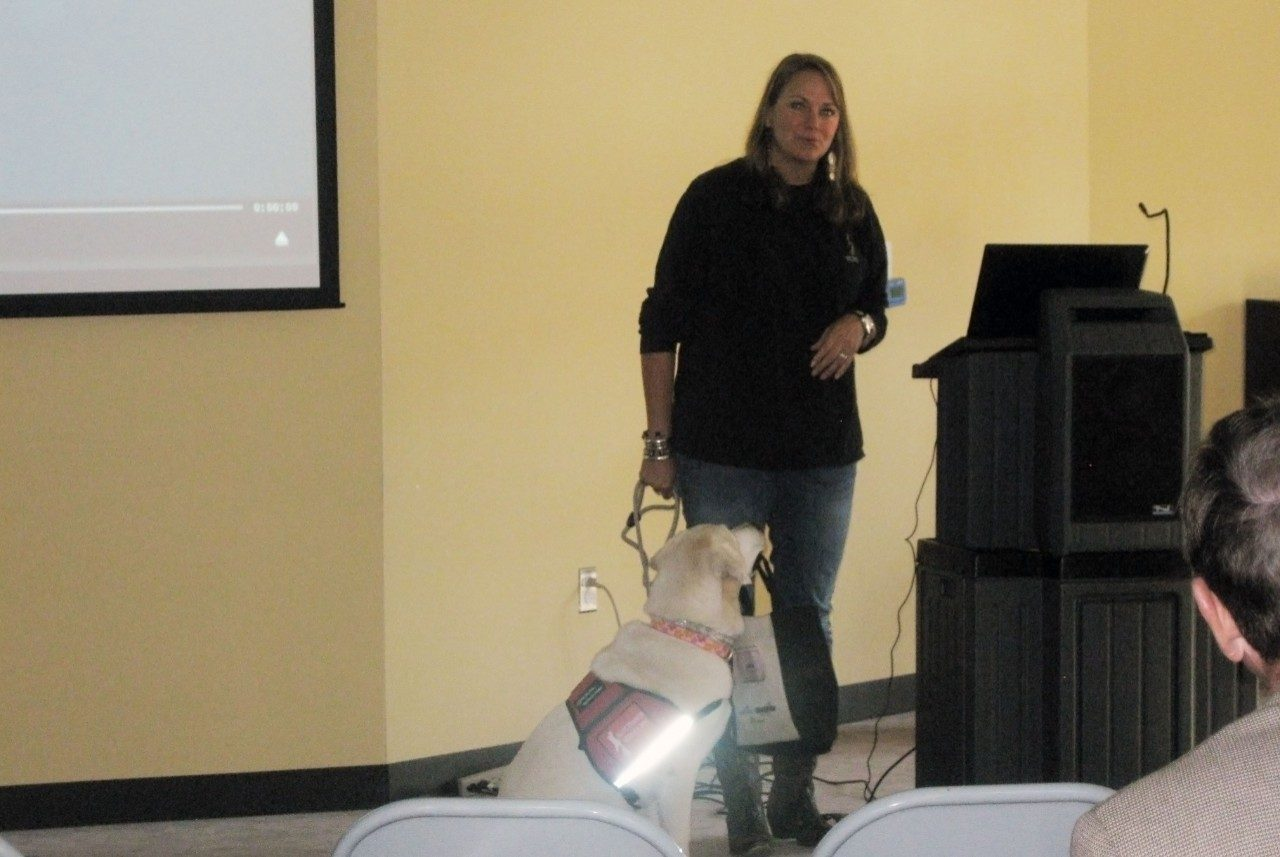 Cabell Youell and Bella training demonstration: Cabell Youell, Executive Director of St. Francis Service Dogs of Roanoke, VA, and her dog Bella, show the audience how service animals are trained and what they can do for their owner.