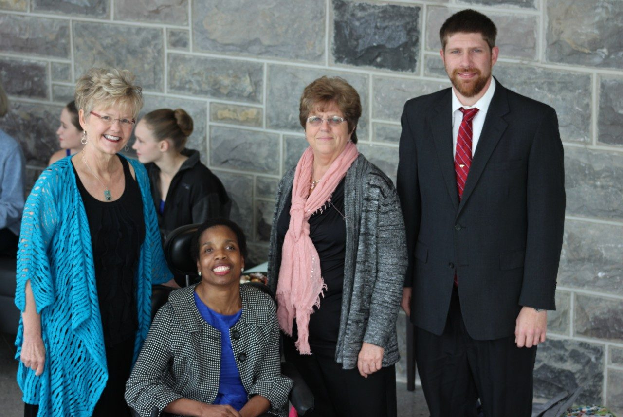 Members of the University ADA Services team pose for a photo with featured guest Carol Crawford Smith