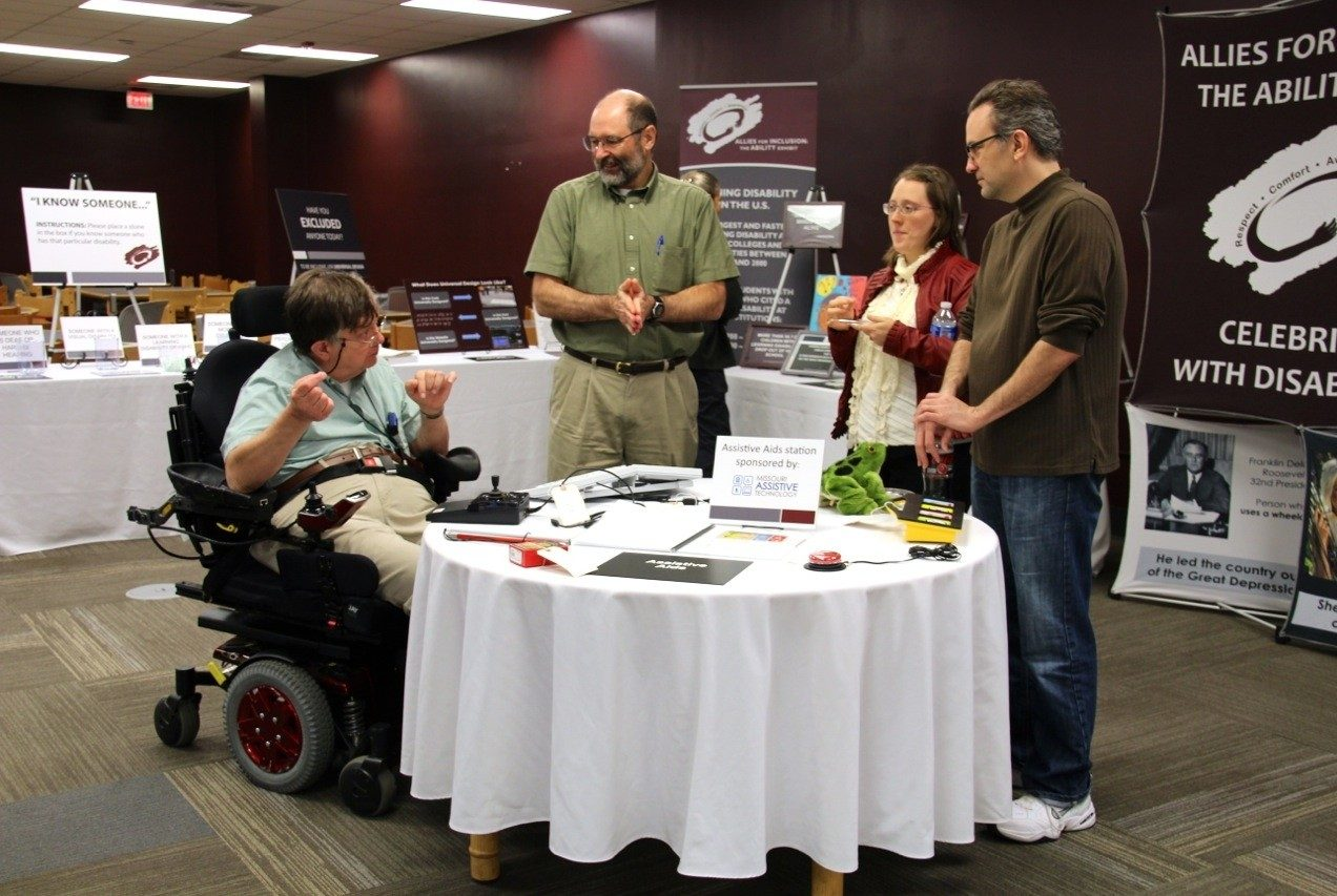 Attendees visit the Assistive Aids Station, which was sponsored by Assistive Technology.