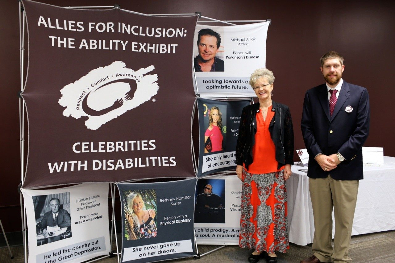 Pam Vickers and Mike Kutnak in front of the Celebrities with Disabilities exhibit.